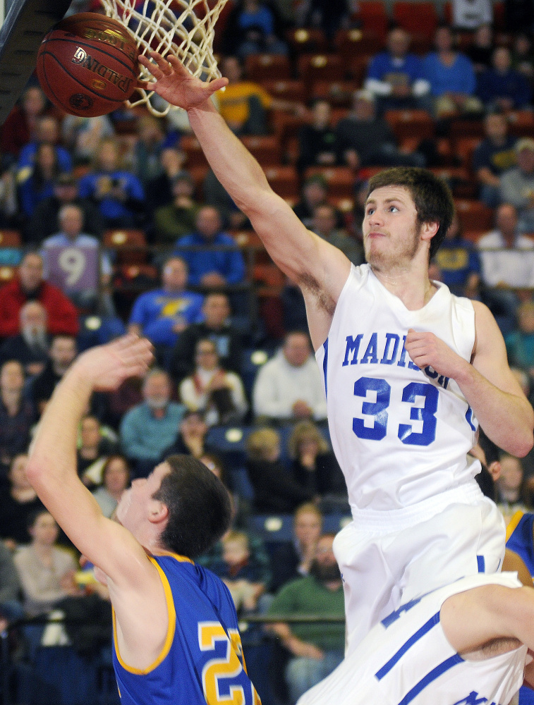 Madison center Mitch Jarvais blocks a shot from Boothbay's Jacob Leonard during a Class C South quarterfinal game last season at the Augusta Civic Center.