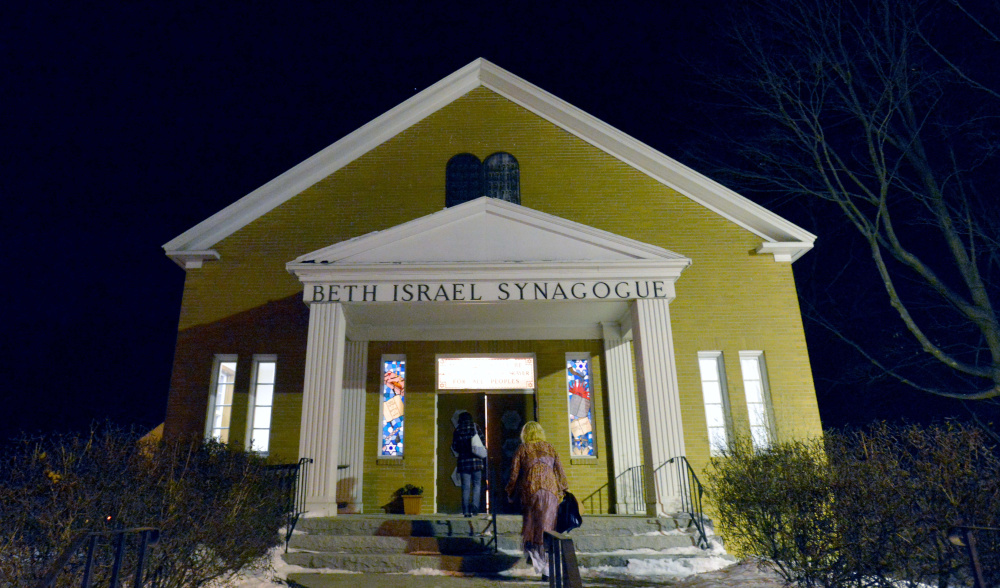 People gather at an interfaith service of healing Friday evening at Beth Israel Congregation in Waterville in response to swastika having been painted on a rock at the city-owned Quarry Road Recreation Area.