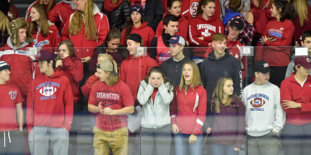 Messalonskee High School hockey fans react during the first period of a game against Winslow last Wednesday at Colby College in Waterville.