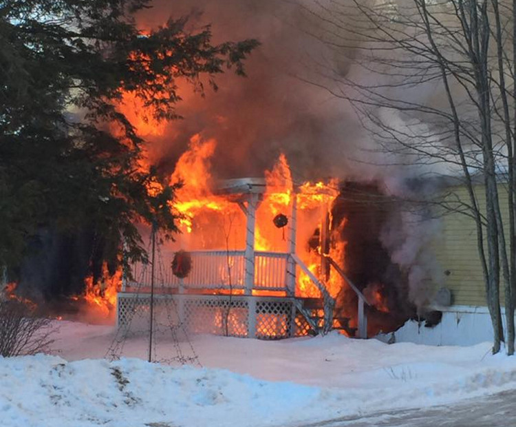 A home burns Tuesday morning at 15 Blue Rock Road in Monmouth.
