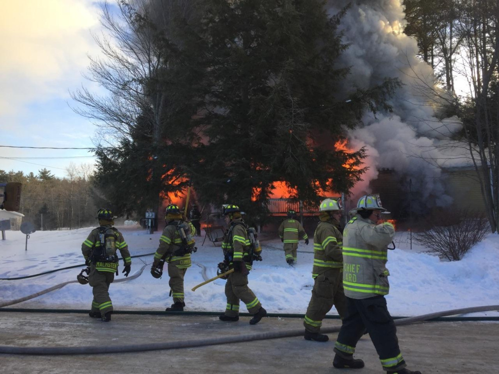 Contributed photo Firefighters work Tuesday at a fire scene at 15 Blue Rock Road in Monmouth, where a mobile home was destroyed.