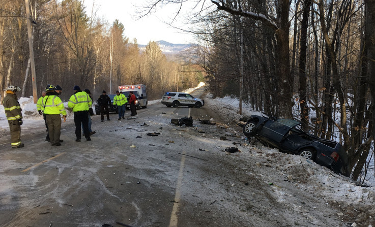 Police and emergency responders work Tuesday morning at the scene of a fatal car crash on Route 145 in Freeman Township.