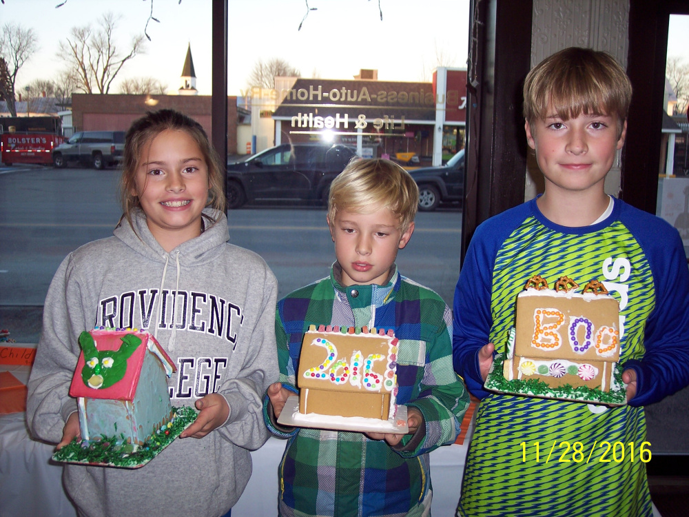 Elle, Finn and Ryan Donoghue with their gingerbread house entries.