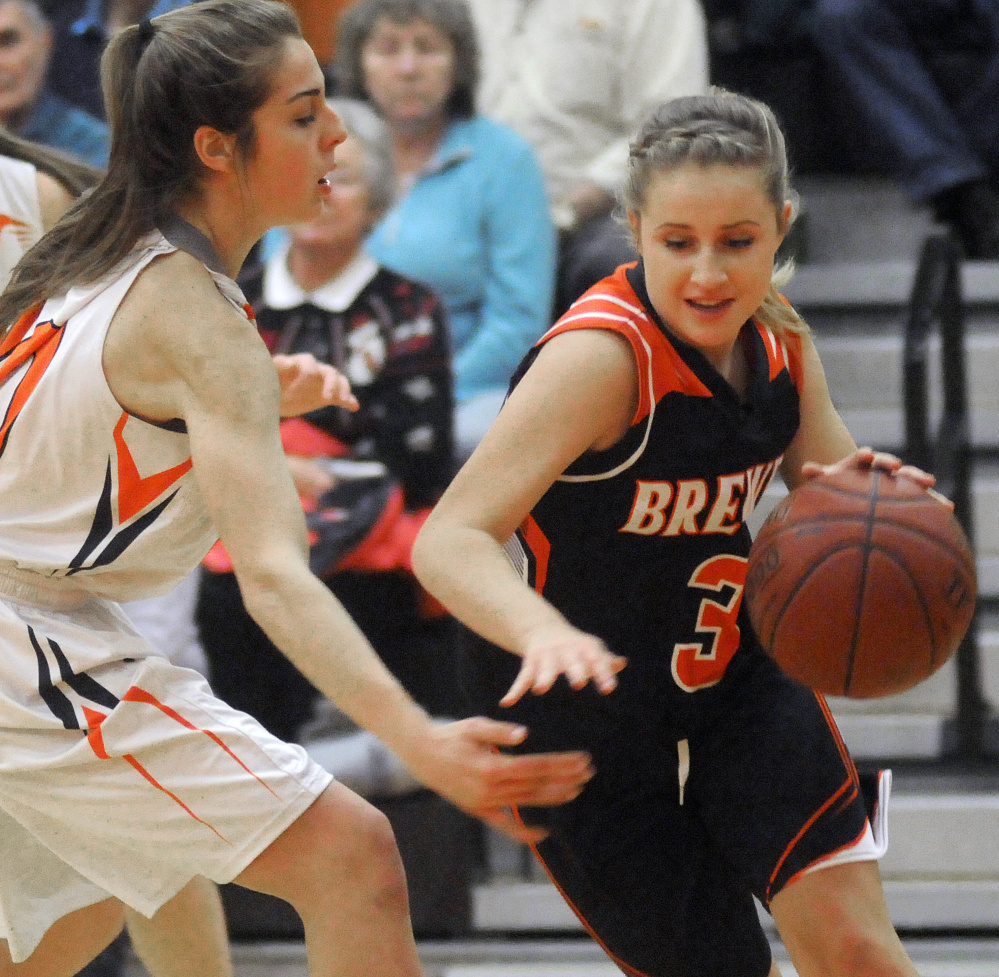 Gardiner's Mary Toman, left, guards Brewer's Ellie Horr during a Class A North game Wednesday in Gardiner.