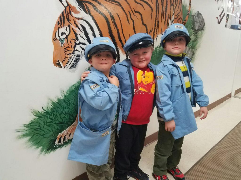 Kindergarten students, from left, Remington Worster, Jacob Baker and Rory Danforth working in Kinder Express Post Office.