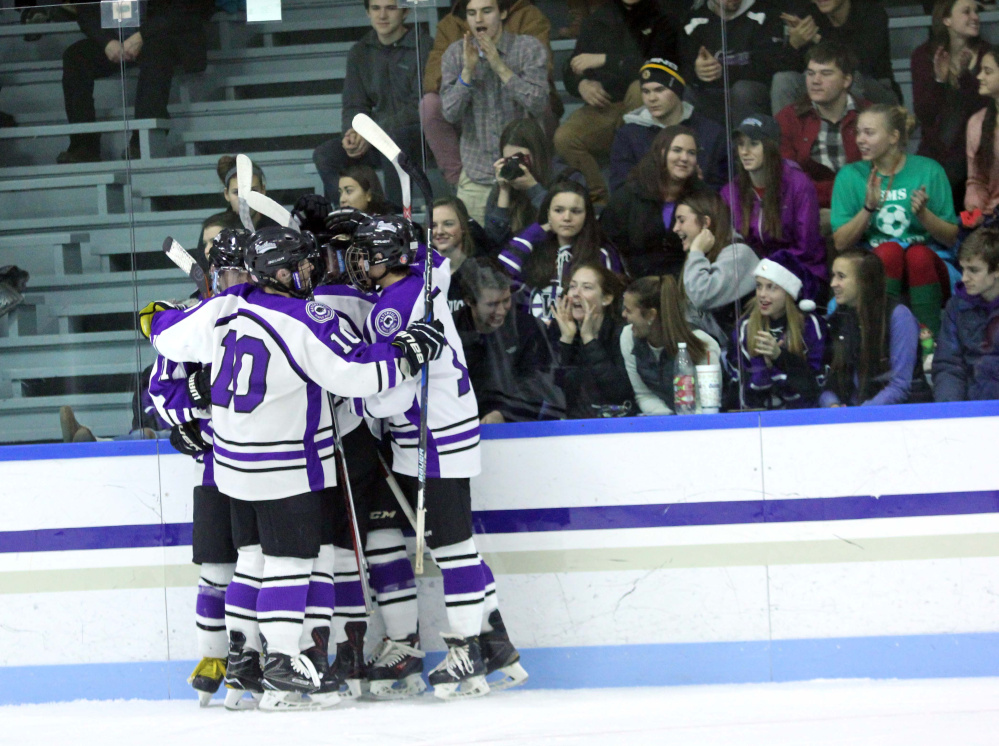 Waterville's Matt Jolicoeur (10) celebrates a Purple Panther goal with teammates and the high school's student section during second-half action against Messalonskee on Thursday at Colby College in Waterville.