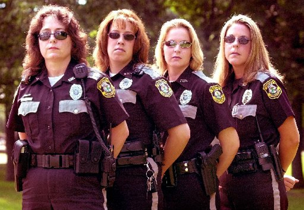 During the early 2000s, Kelly Hooper, far right, worked with three other female police officers in the Fairfield Police Department: from left, Karen Pomelow, Amie Trahan and Shanna Messer.