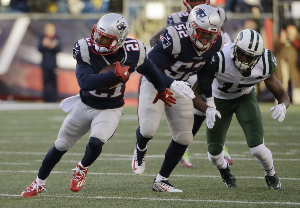 New England Patriots cornerback Malcolm Butler (21) runs with the ball after intercepting a pass intended for New York Jets wide receiver Charone Peake (17) during the second half Saturday in Foxborough, Massachusetts. Butler had two interceptions and a fumble recovery in the game.