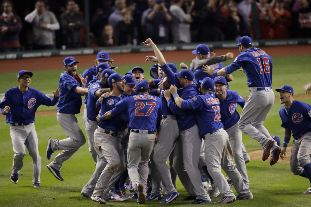 The Chicago Cubs celebrate after Game 7 of the World Series against the Cleveland Indians in November in Cleveland. The Cubs won 8-7 in 10 innings to win the series 4-3.