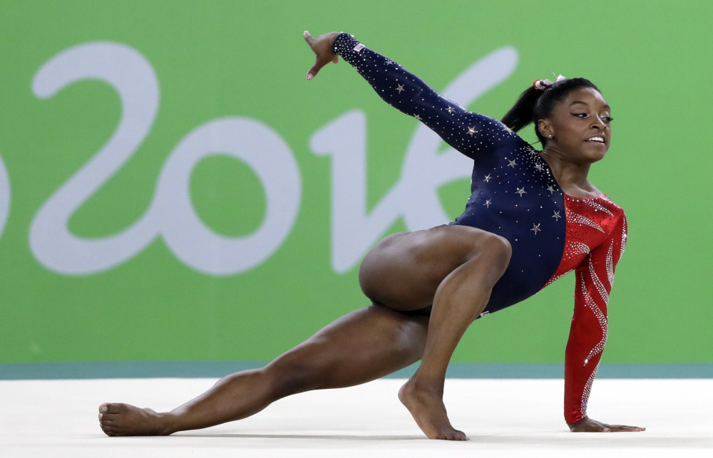 Simone Biles performs on the floor during the artistic gymnastics women's qualification at the 2016 Summer Olympics in August in Rio de Janeiro, Brazil. Biles was selected as the AP Female Athlete of the Year on Monday.