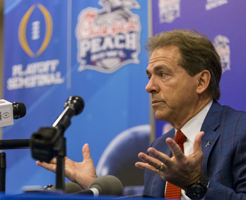 Alabama football coach Nick Saban talks with the media during a Peach Bowl press conference Monday in Atlanta. Alabama takes on Washington on Saturday.