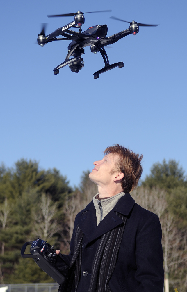 Photographer Thomas-john Veilleux operates a drone last week in Augusta.