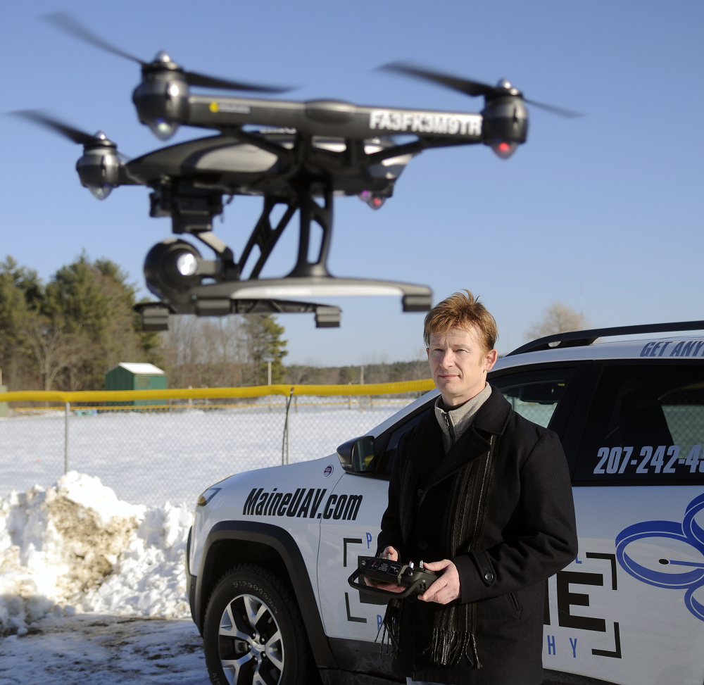Photographer Thomas-john Veilleux operates a drone last week in Augusta while discussing the technological and regulatory hurdles he's had to overcome with the expansion of his photography business.