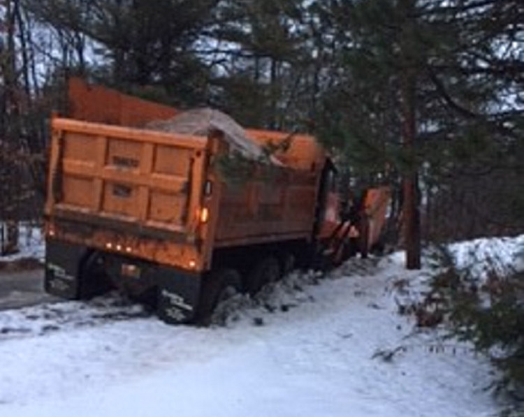 A Waterville Public Works truck went off the road on Country Way Monday night during icy conditions.