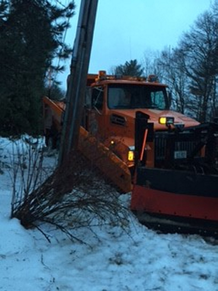 This Waterville Public Works truck was one of three that slid off area roadways while treating with salt and sand Monday night and Tuesday morning.
