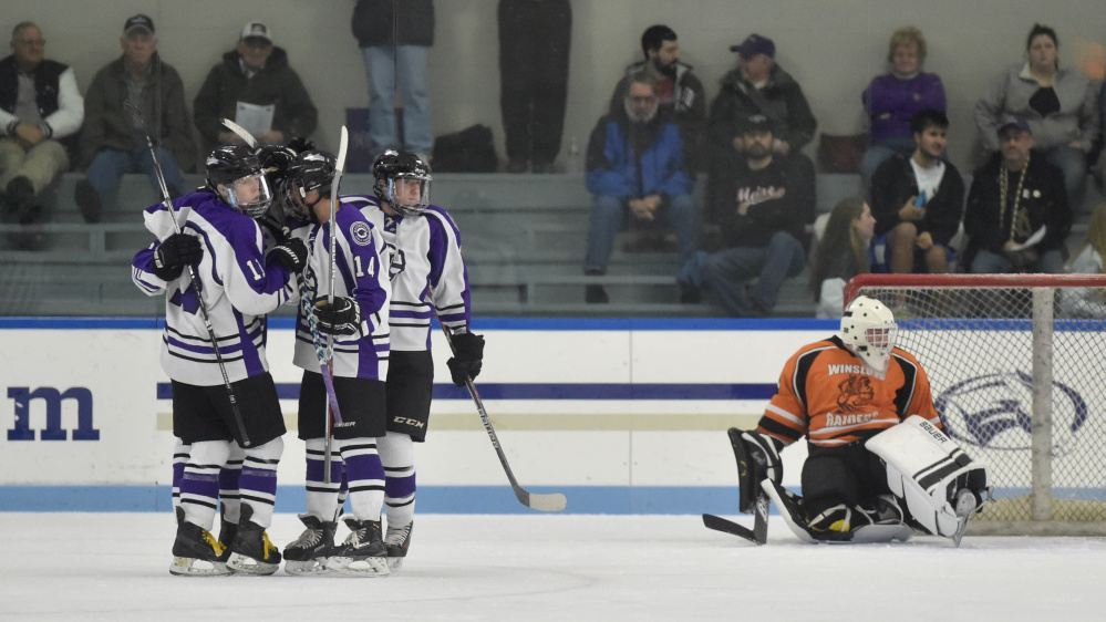 Waterville celebrates a first period goal against Winslow on Tuesday at Colby College in Waterville.