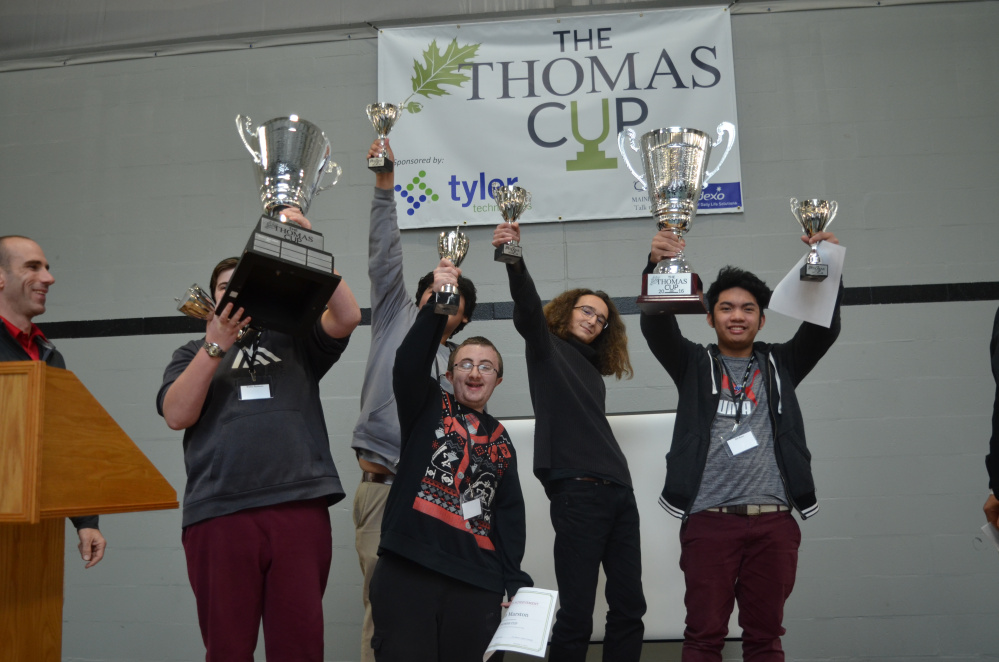 A group of students from Portland's Baxter Academy for Technology and Science won the Thomas Cup, Thomas College's IT and gaming competition that took place on Dec. 2-3. The winners front, from left, were Walter Backman, behind cup; Caleb Marston, Julian Bernard and Antonio Custodio. John Zarate is in back.