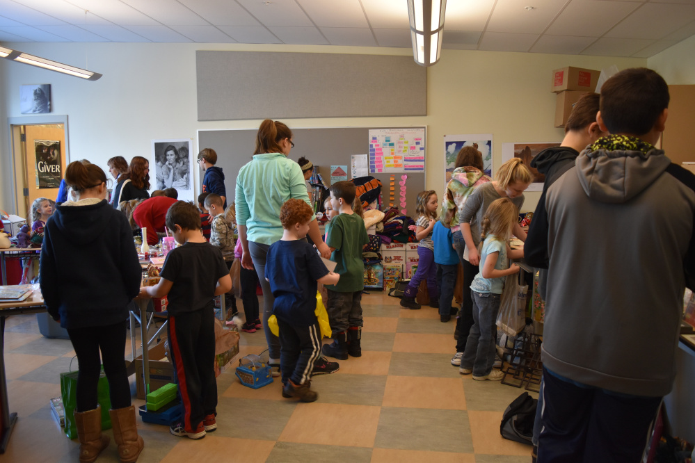 Chelsea Elementary School seventh- and eighth-grade students acted as personal shopping assistants and gift wrappers for younger students who were buying gifts for their families during the school's annual Holiday Table.