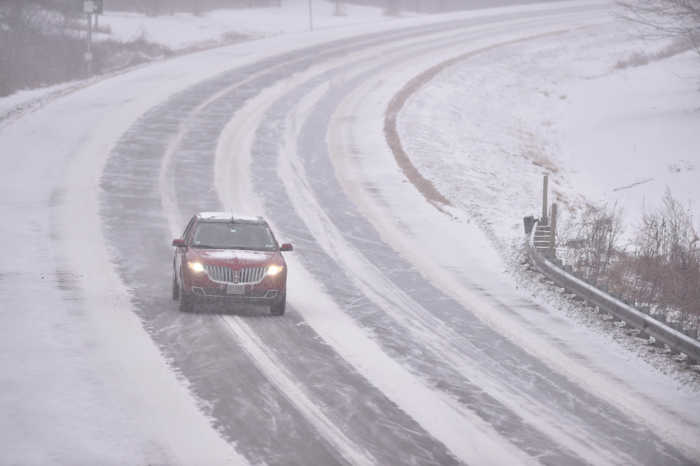 Traffic slows to 45 mph on the north lane of Interstate 95 in Waterville on Thursday as a Nor'easter hits the region.
