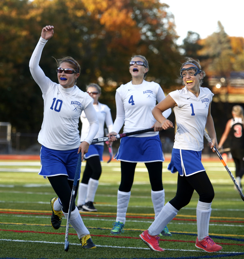 Oak Hill teammates Kylee Veilleux, left, Maegan Sheehy (4) and Erika Hannigan celebrate a goal during the second half of the Class C South championship game last season at Fitzpatrick Stadium in Portland.