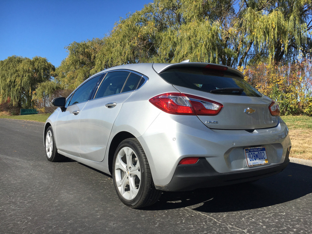 The rear wheels are tucked close to the tail and the integrated spoiler at the top of the hatch gives it an edge. The Premier trim level comes upgraded with unremarkable 18-inch wheels.