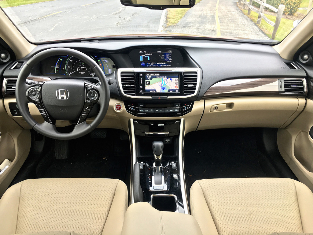The interior on the premium Touring trim is more like Acura than Honda, with cream-colored leatherette seats and wood accents in the dash.