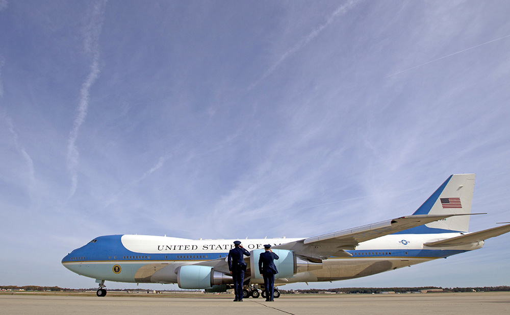 Military personnel salute as Air Force One, with President Barack Obama aboard, departs at Andrews Air Force Base, Md., on Nov. 6, 2016. President-elect Donald Trump wants the government's contract for a new Air Force One fleet to be canceled.  <em>Associated Press/Jose Luis Magana</em>