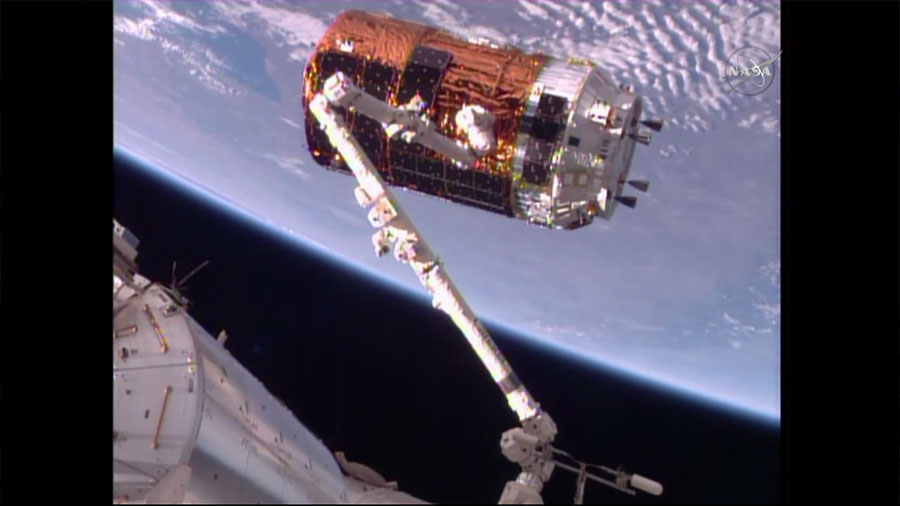 The space station's Canadarm2 snags Japan's HTV-6 cargo craft in preparation for a resupply delivery on Tuesday morning, Dec. 13, 2016.