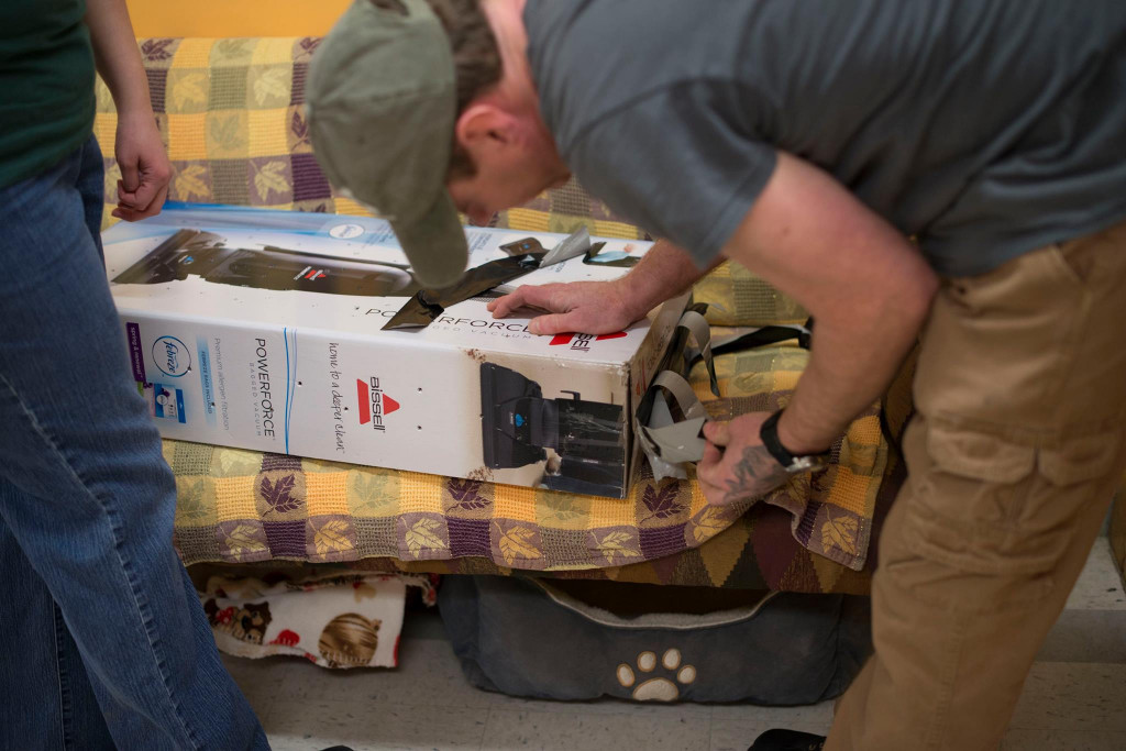 Staff open a vacuum cleaner box to find a surprise kitten inside. The box was left outside at the front door of the Franklin County Animal Shelter Thursday.