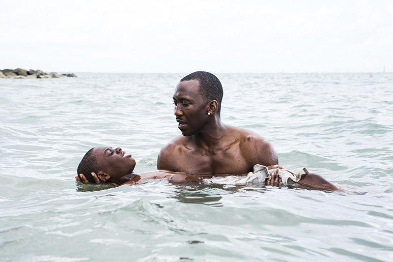 """Alex Hibbert, foreground, and Mahershala Ali in a scene from the film, """"Moonlight."""""""