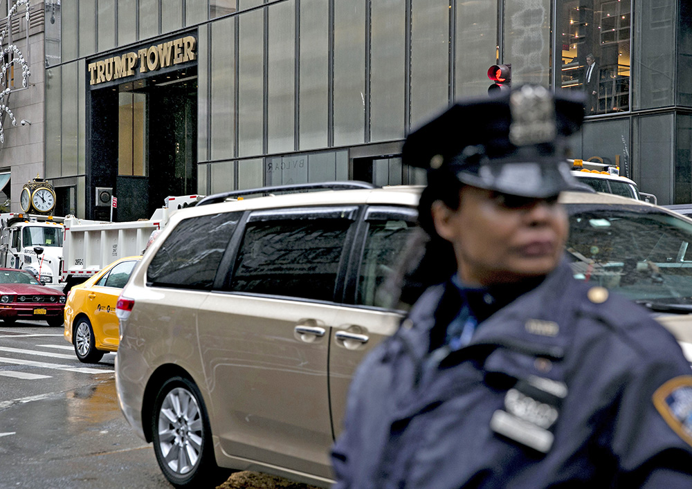 A New York Police Department officer watches over a closed pedestrian intersection across the street from Trump Tower in New York recently. <em>Bloomberg/Daniel Acker</em>