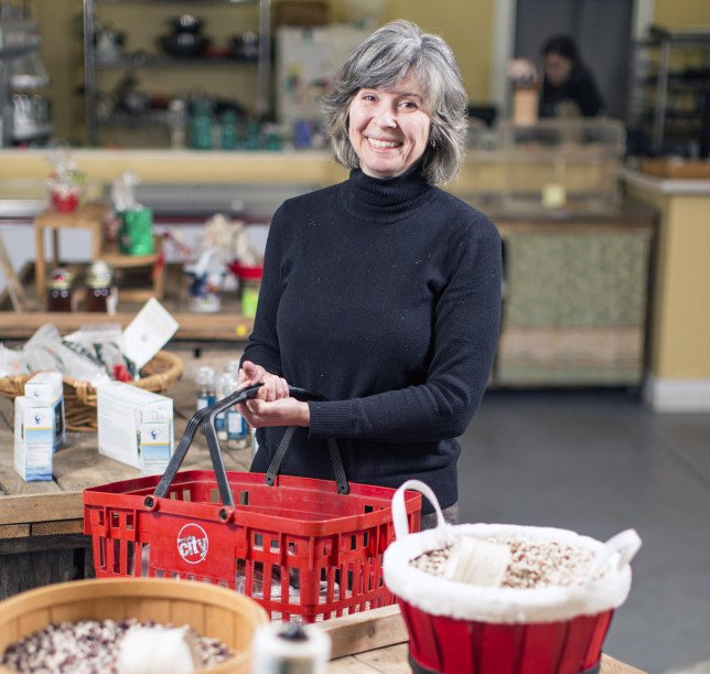 Tanya Swain holds a basket of items from Sandy River Farm Market.