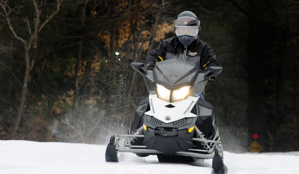 Alan Swett, Maine Snowmobile Association safety chairman, takes a spin Thursday in Augusta.