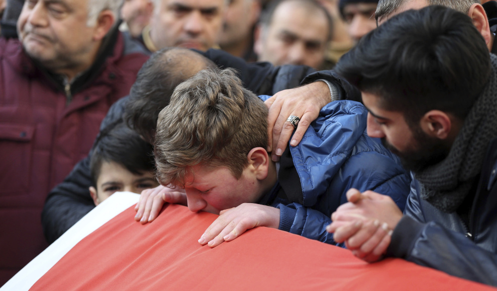 Family and friends mourn at a funeral for one of 39 victims of the New Year's Eve shooting. Most of the dead were young foreigners.