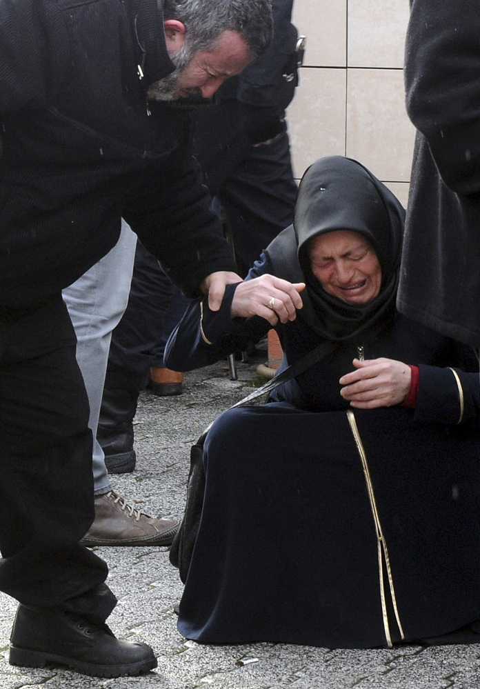 Family members of victims cry outside an Istanbul hospital Sunday. The shooting at a nightclub on New Year's Eve was the fourth major attack in Turkey in less than a month.
