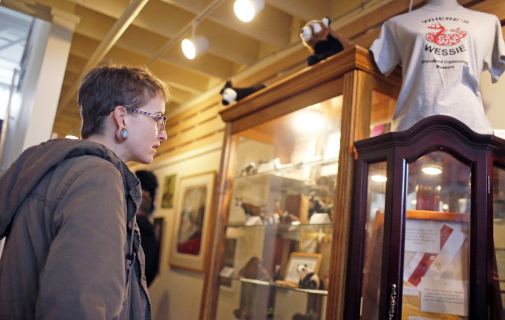 Ashlynn Sylvain of Philadelphia looks over the Wessie the snake exhibit at the International Cryptozoology Museum.