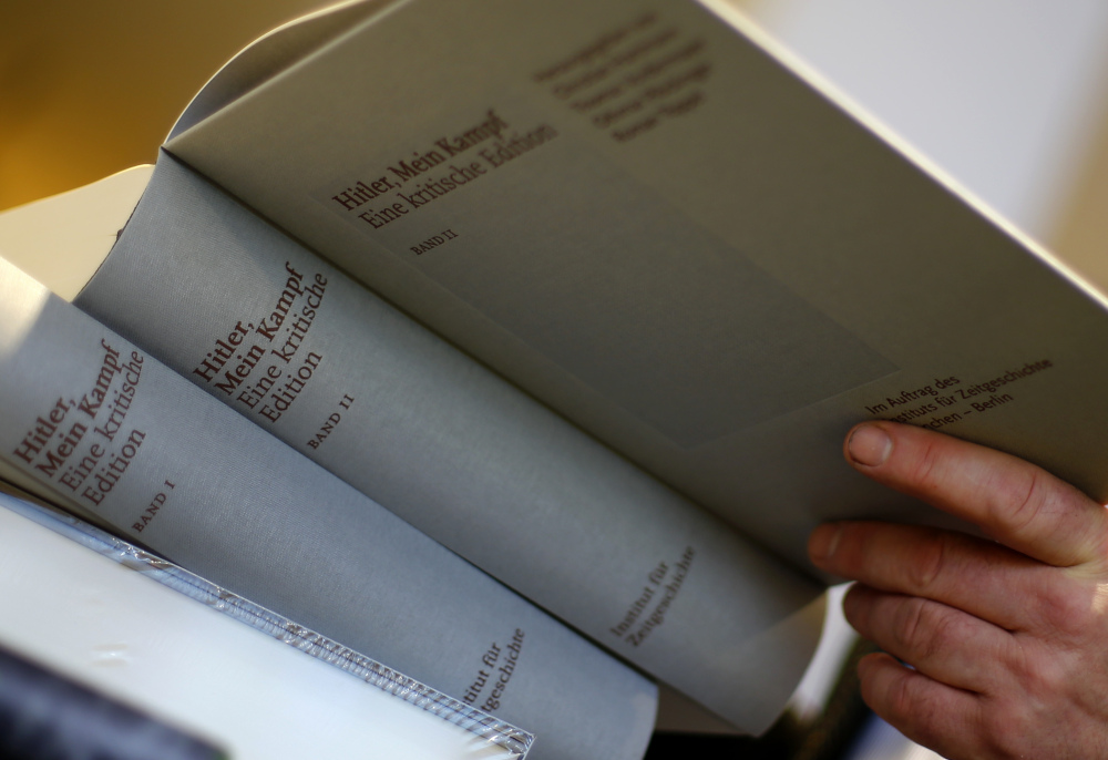 """The bulky, two-volume edition of """"Hitler, Mein Kampf – A critical edition"""" is sold in Munich, Germany. Commentary is added in an effort to point out Hitler's propaganda and mistakes."""