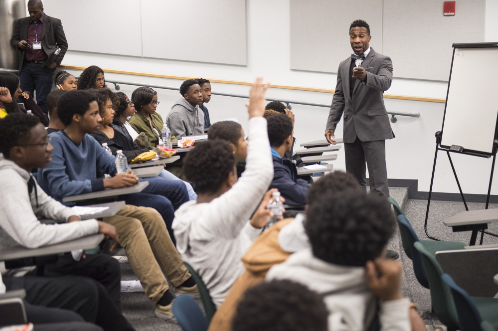 "Daon McLarin Johnson, leader of an organization that mentors young men in the Washington, D.C., area, speaks during a ""Race and the Law"" forum. More than 50 such events are scheduled across the nation in the first three months of 2017."