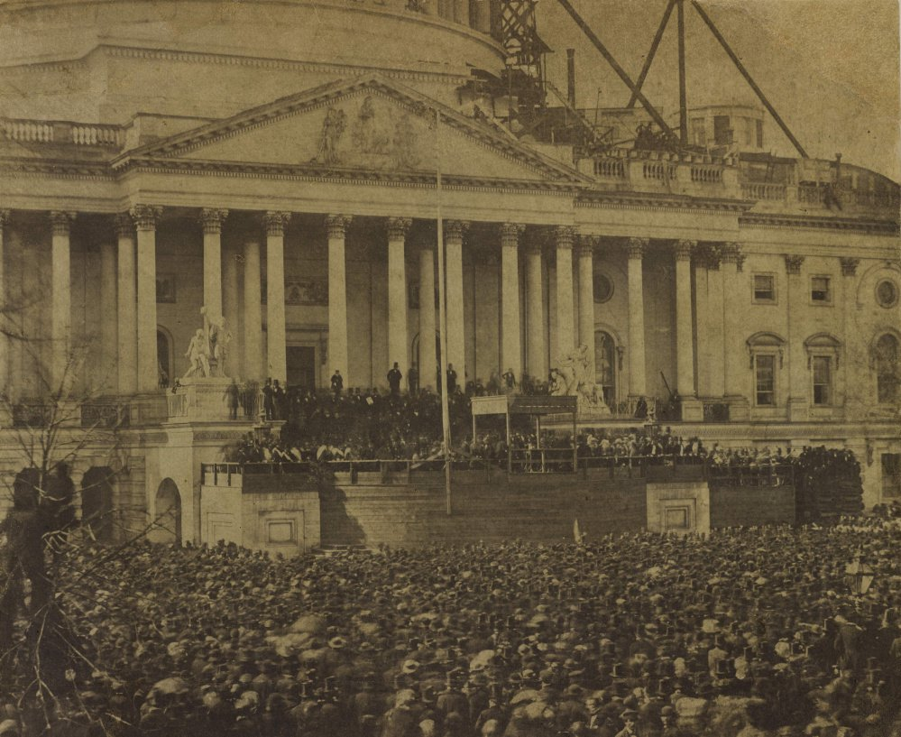 This photograph of the first inauguration of Abraham Lincoln taken on March 4, 1861, is attributed to photographer Alexander Gardner. The Capitol dome in Washington, D.C., was only partially built at the time.