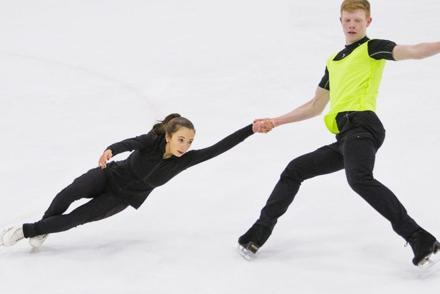 Yarmouth High School sophomore Franz-Peter Jerosch and partner Jade Esposito of Massachusetts practice their pairs figure skating routine at the Family Ice Center in Falmouth.