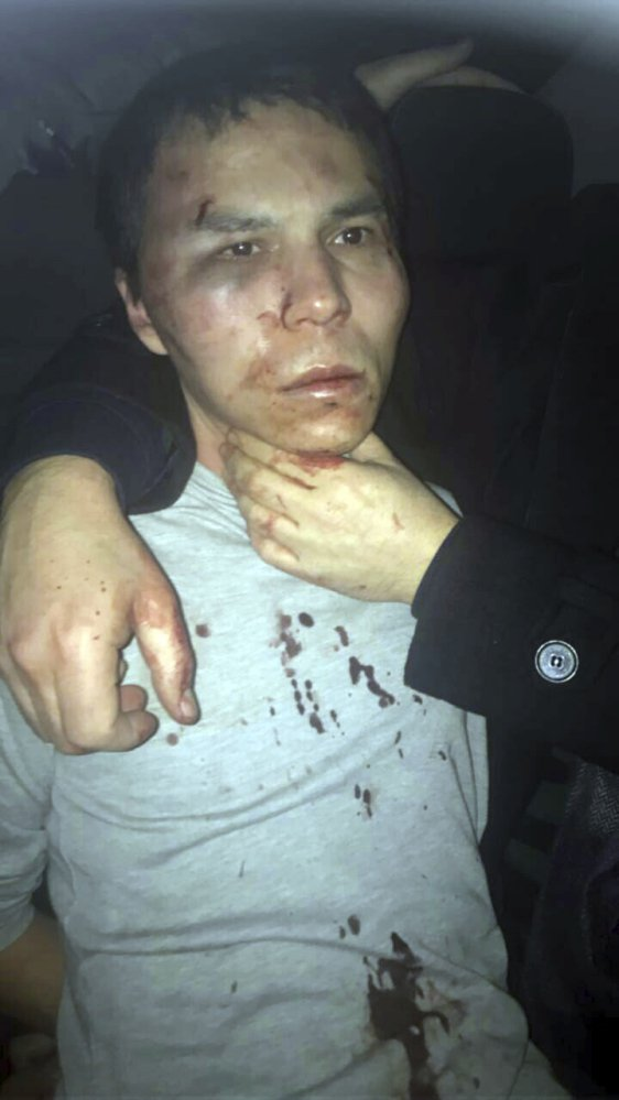 The first published image of the suspect shows a bruised, black-haired man in a bloodied shirt being held by his neck. NTV television said the man had resisted arrest. Turkish media have identified the nightclub gunman as Abdulkadir Masharipov, an Uzbekistan national.