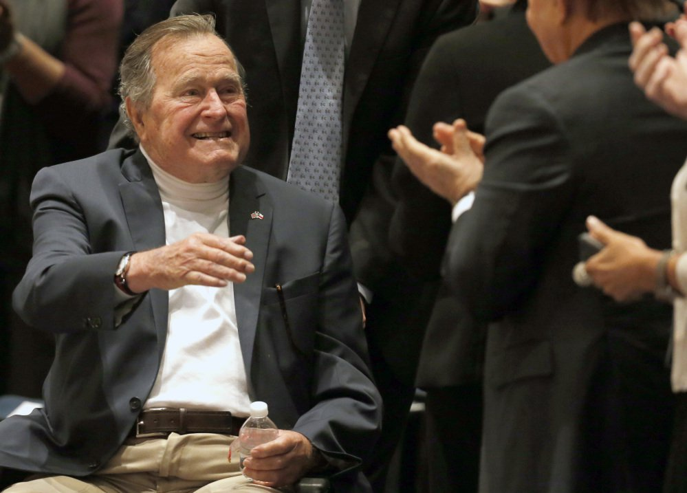 Former President George H.W. Bush, shown acknowledging the crowd at his presidential library in 2014, was released from a Houston hospital Monday after a two-week stay for treatment of pneumonia.