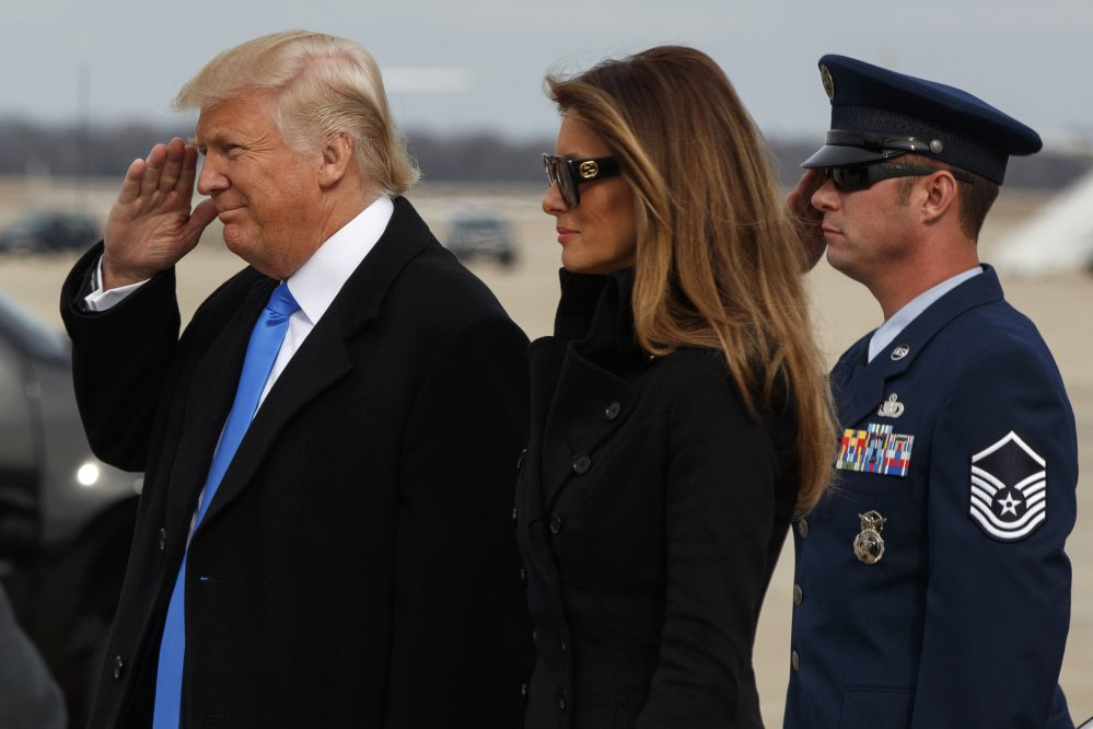 President-elect Donald Trump salutes as he and his wife, Melania, arrive at Andrews Air Force Base, Maryland, on Thursday in preparation for Friday's inauguration.