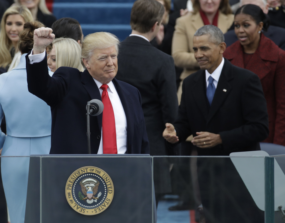 President Donald Trump waves after being sworn in as the 45th president of the United States during the 58th Presidential Inauguration at the U.S. Capitol in Washington on Friday.