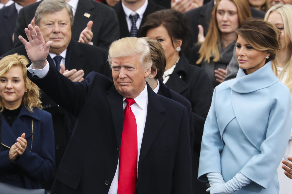 President-elect Donald Trump waves from the podium, with Melania Trump at right, during the 58th Presidential Inauguration at the U.S. Capitol in Washington on Friday.