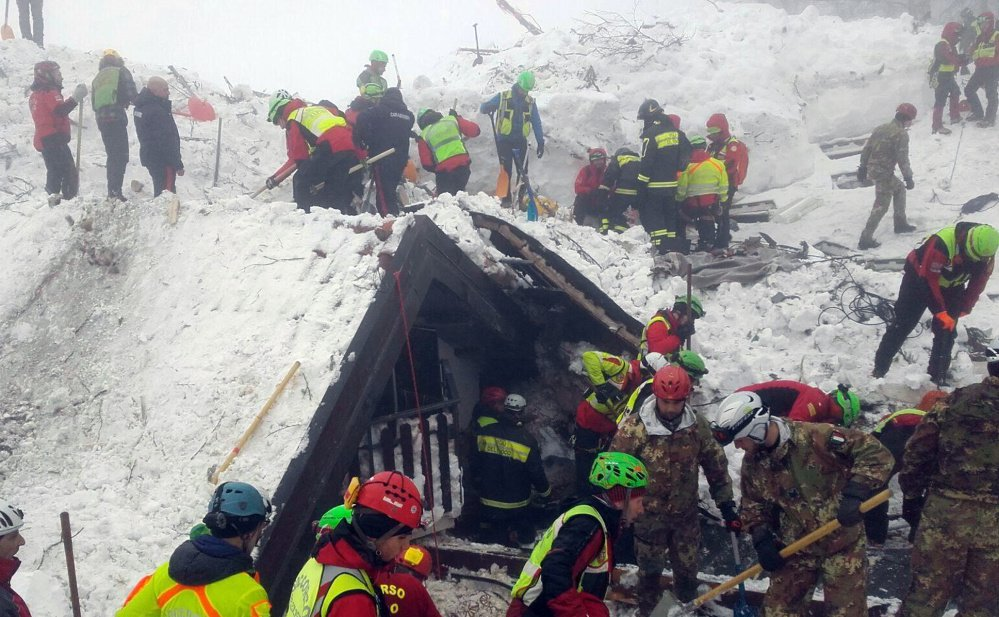 "Rescuers work at the site of the avalanche-demolished Rigopiano hotel in central Italy. After two days huddled in freezing cold, with tons of snow surrounding them in the wreckage of the hotel, survivors greeted their rescuers as ""angels."""