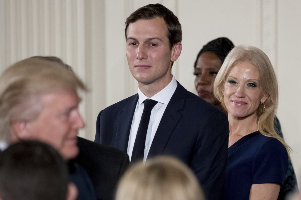 White House Senior Advisor Jared Kushner and Counselor to the President Kellyanne Conway watch as President Trump congratulates other senior staff during a swearing-in ceremony in the East Room of the White House on Sunday in Washington.