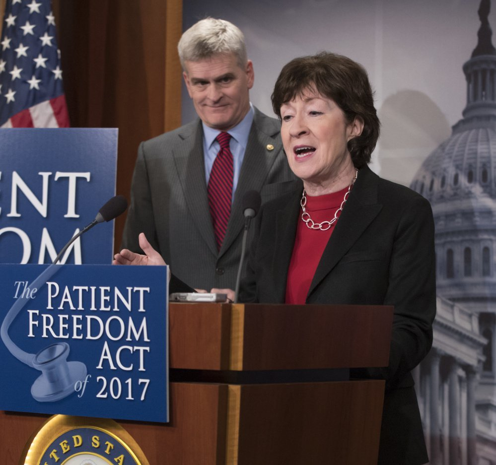 Sen. Bill Cassidy, R-La., listens on Jan. 23 as Maine Sen. Susan Collins discusses her Affordable Care Act replacement plan.