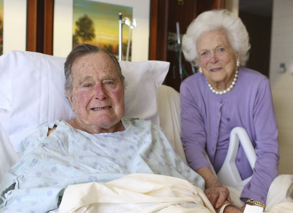 Former President George H.W. Bush and his wife, Barbara, pose for a photo at Houston Methodist Hospital in Houston. The 92-year-old former president is still suffering from pneumonia, but is well enough to leave the intensive care unit.