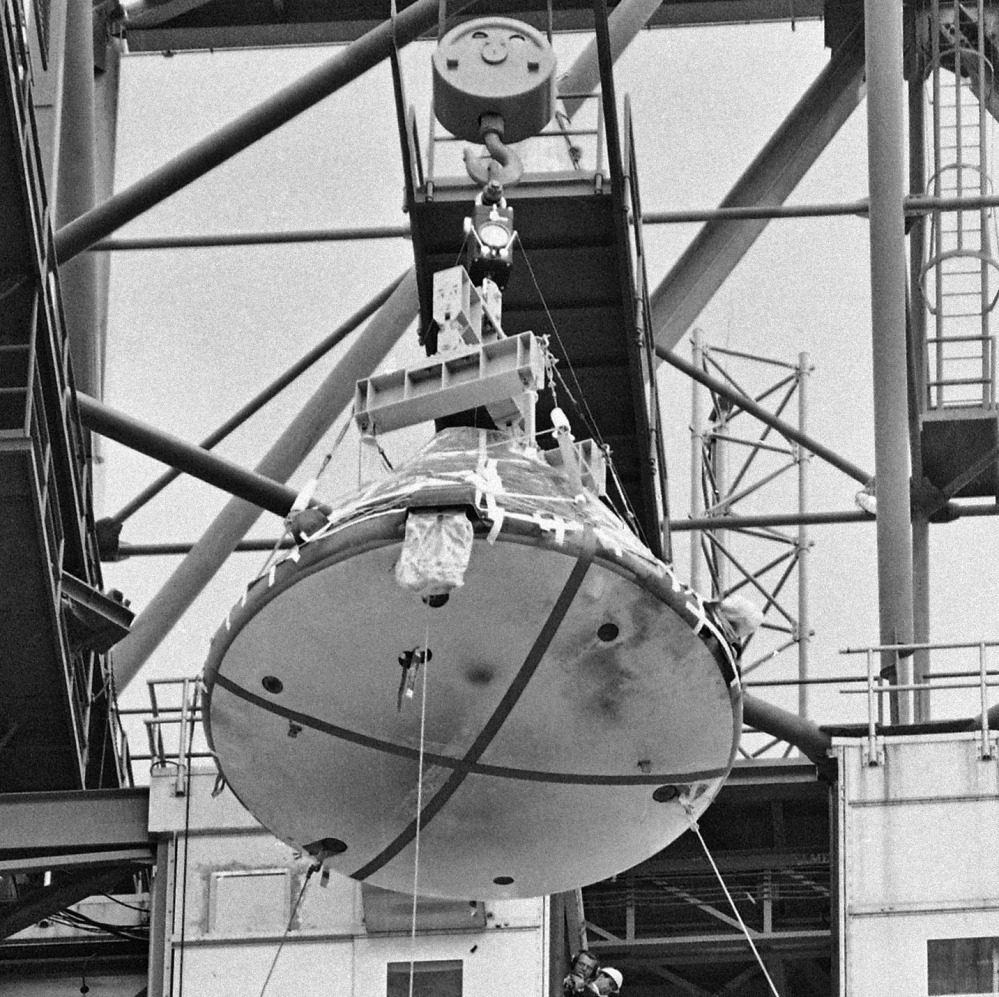 The Apollo 1 capsule, with black smudge marks visible on the heat shield, is transported at Cape Kennedy, Fla., in February 1967 after a fire on the launch pad killed three astronauts.